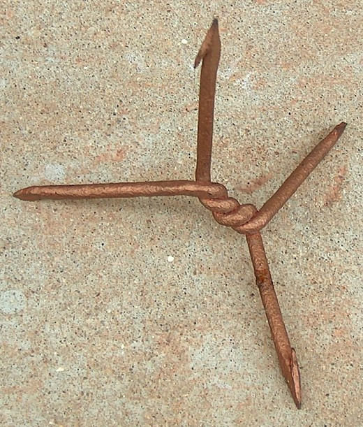 https://upload.wikimedia.org/wikipedia/commons/5/59/Caltrop_from_Vietnam_1968.jpg