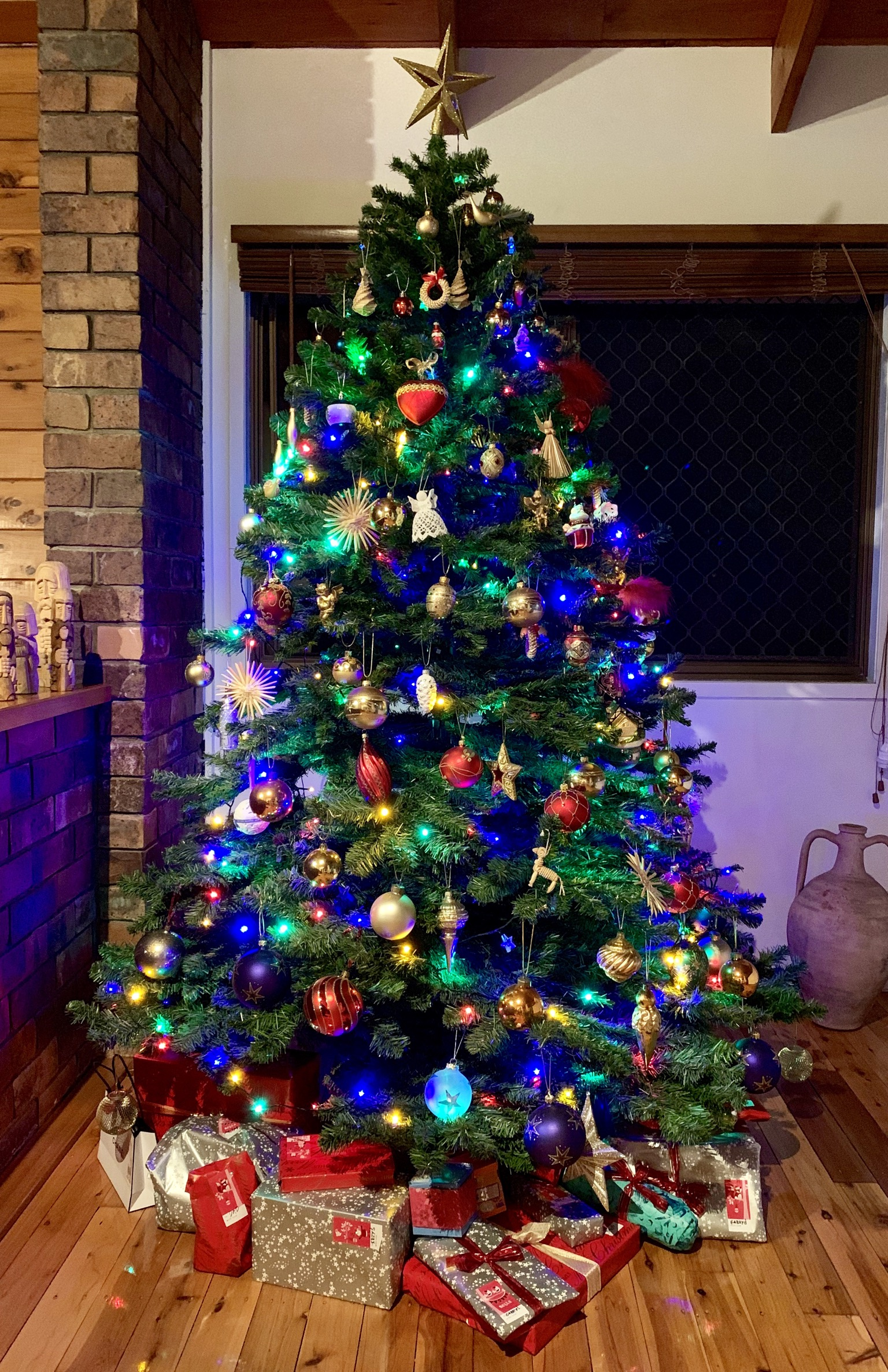 Christmas_tree_with_presents_in_a_privite_house_on_Christmas_Eve_night.jpg?profile=RESIZE_710x