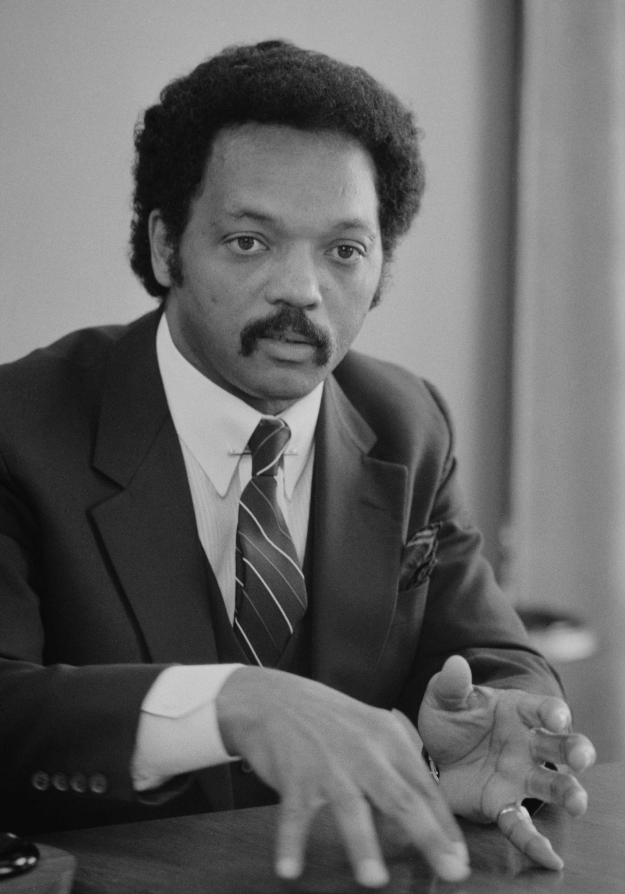 Description Jesse Jackson, half-length portrait of Jackson seated at a