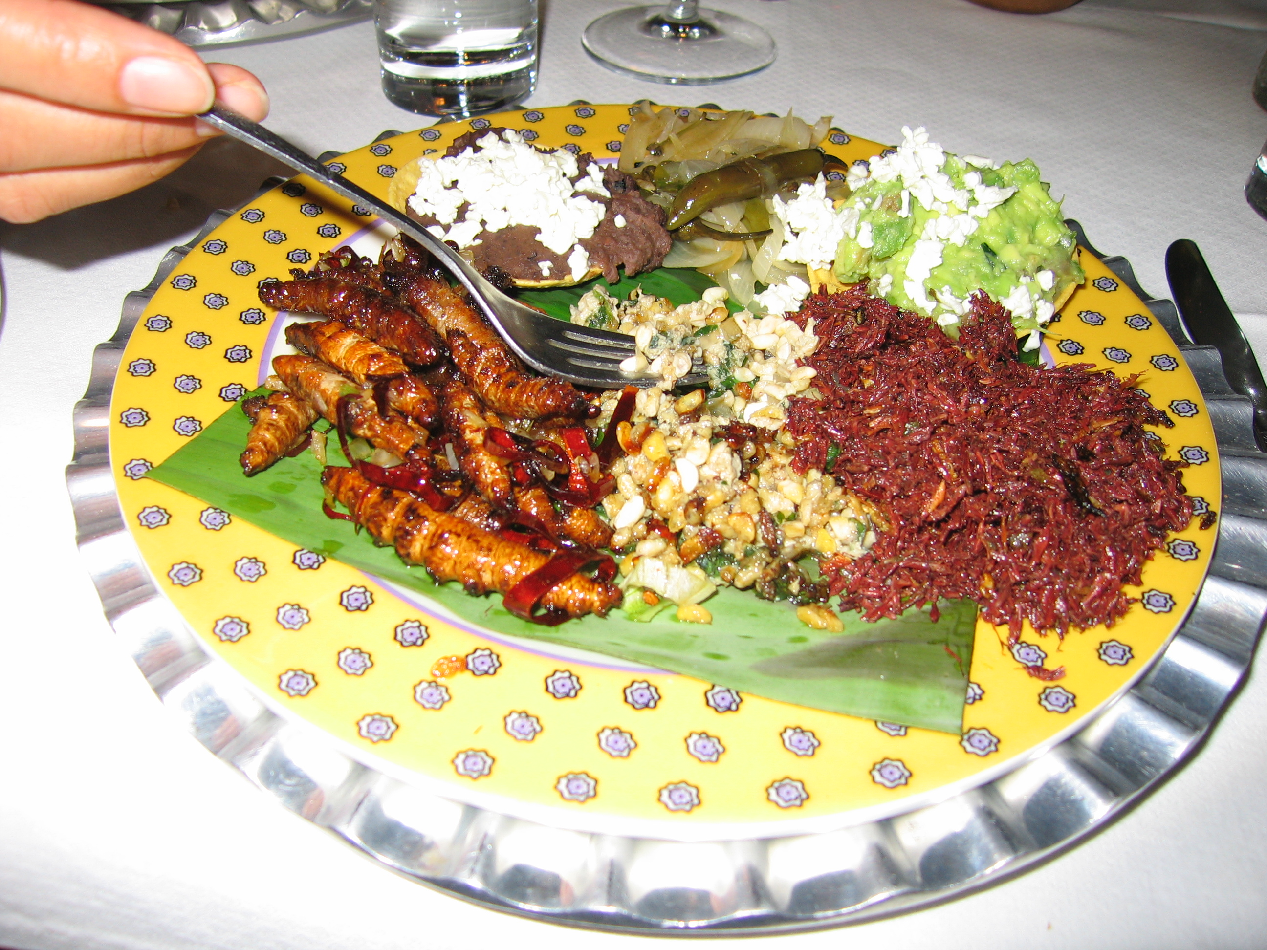 File:Larvae, ant eggs and grasshoppers dish.jpg - Wikimedia Commons