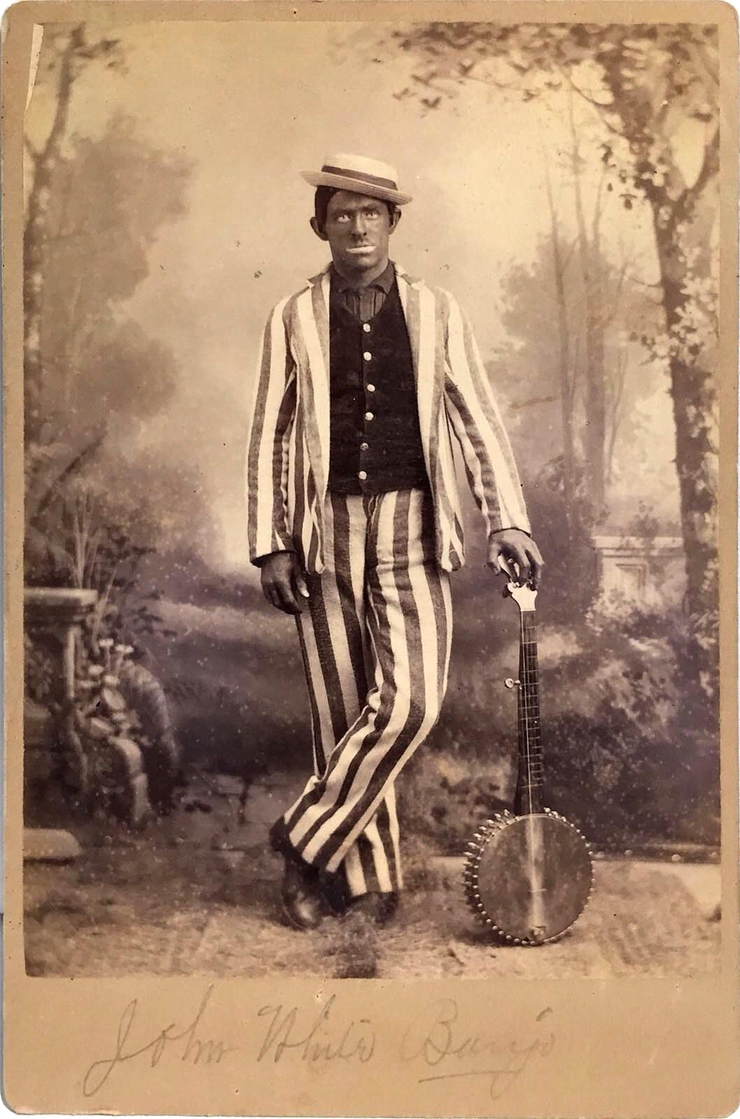 File:Blackface minstrel John White with Banjo c1890.png - Wikimedia Commons