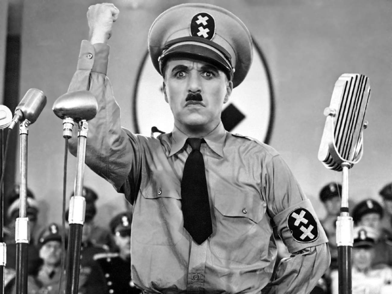 Charlie Chaplin satirizing Adolf Hitler in The Great Dictator