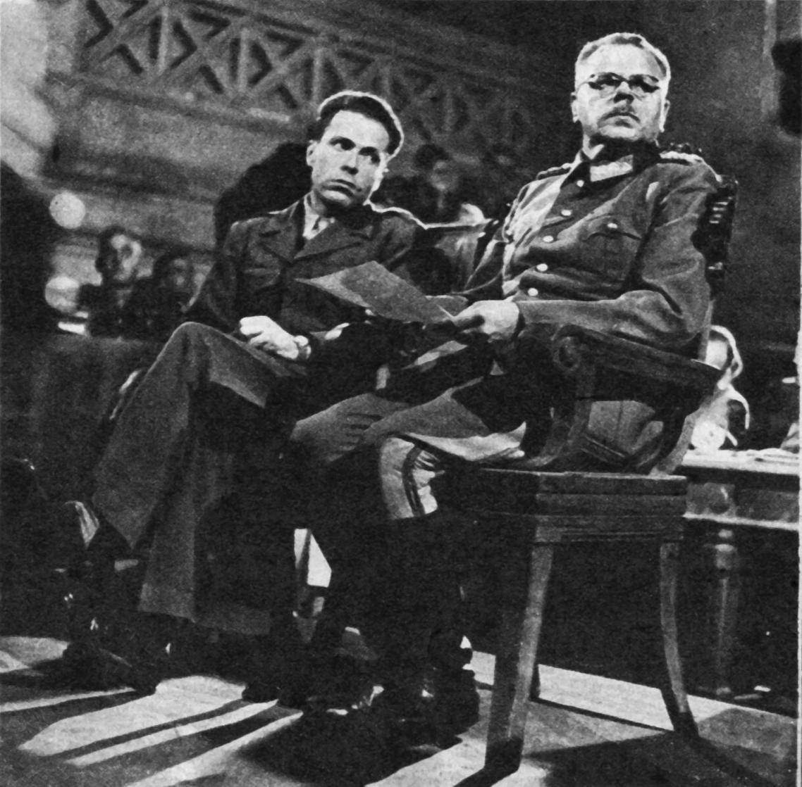 Hirschman (left) interpreting for the accused German [[Anton Dostler]] in Italy 1945