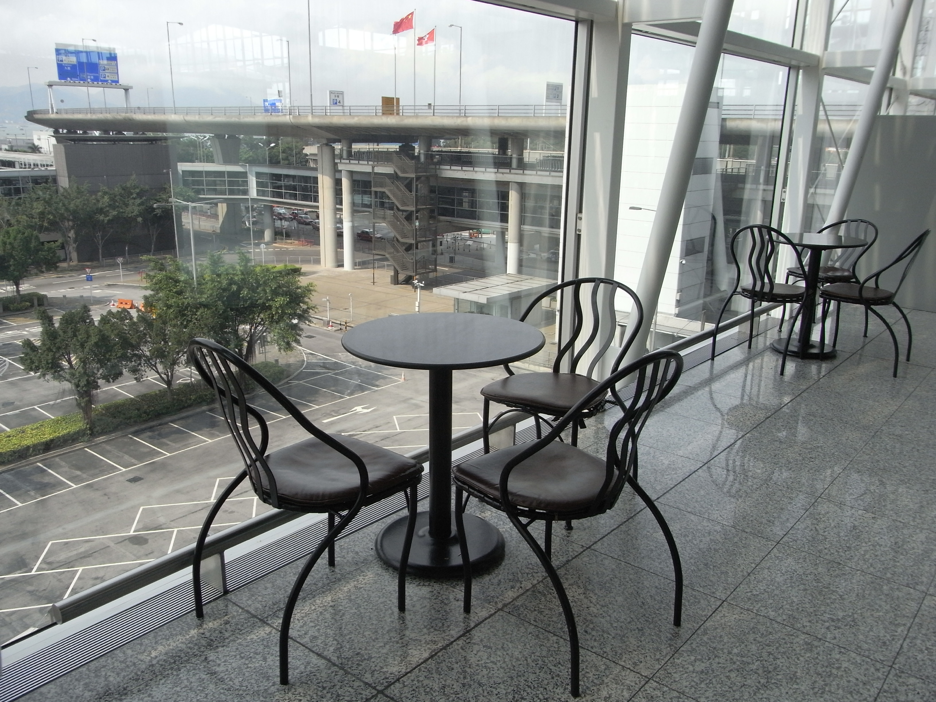 File:HK Airport Terminal 1 Pacific Coffee Restaurant Table Chairs Glass  Wall View Chek Lap