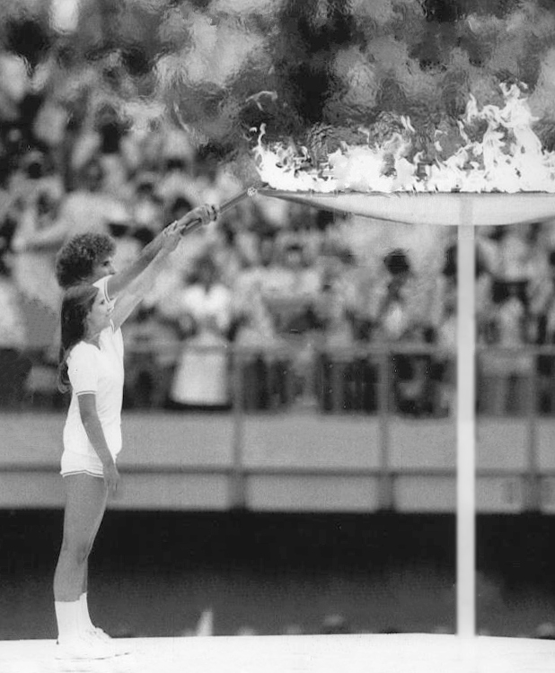 Préfontaine and Henderson lighting the Olympic Flame