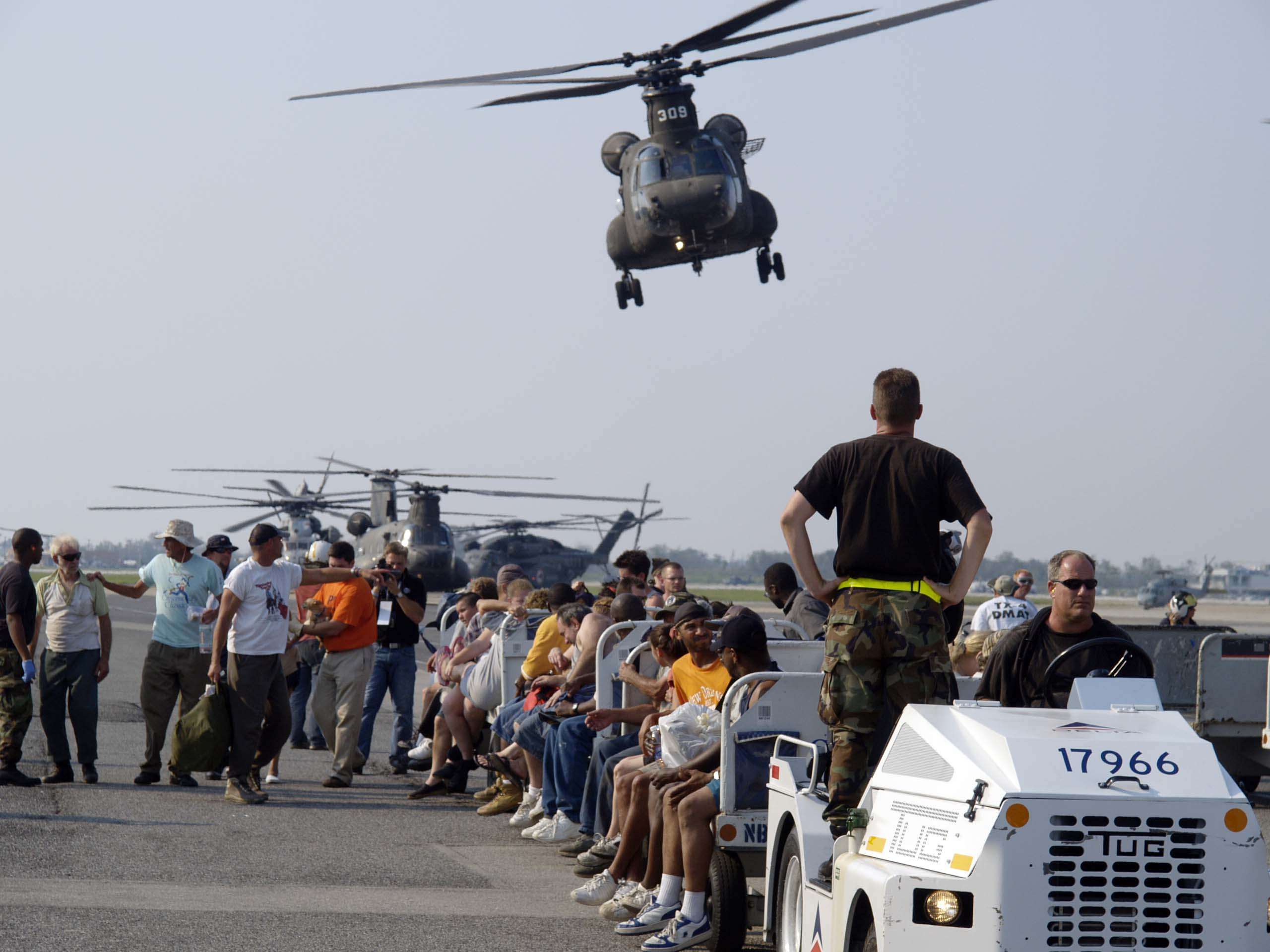 http://upload.wikimedia.org/wikipedia/commons/5/5a/Survivors_of_hurricane_Katrina_arrive_at_New_Orleans_Armstrong_Airport_14592.jpg