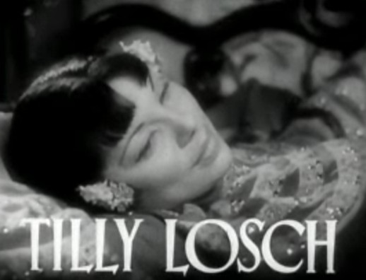 Tilly Losch, reclining, with her name in large letters at bottom of frame