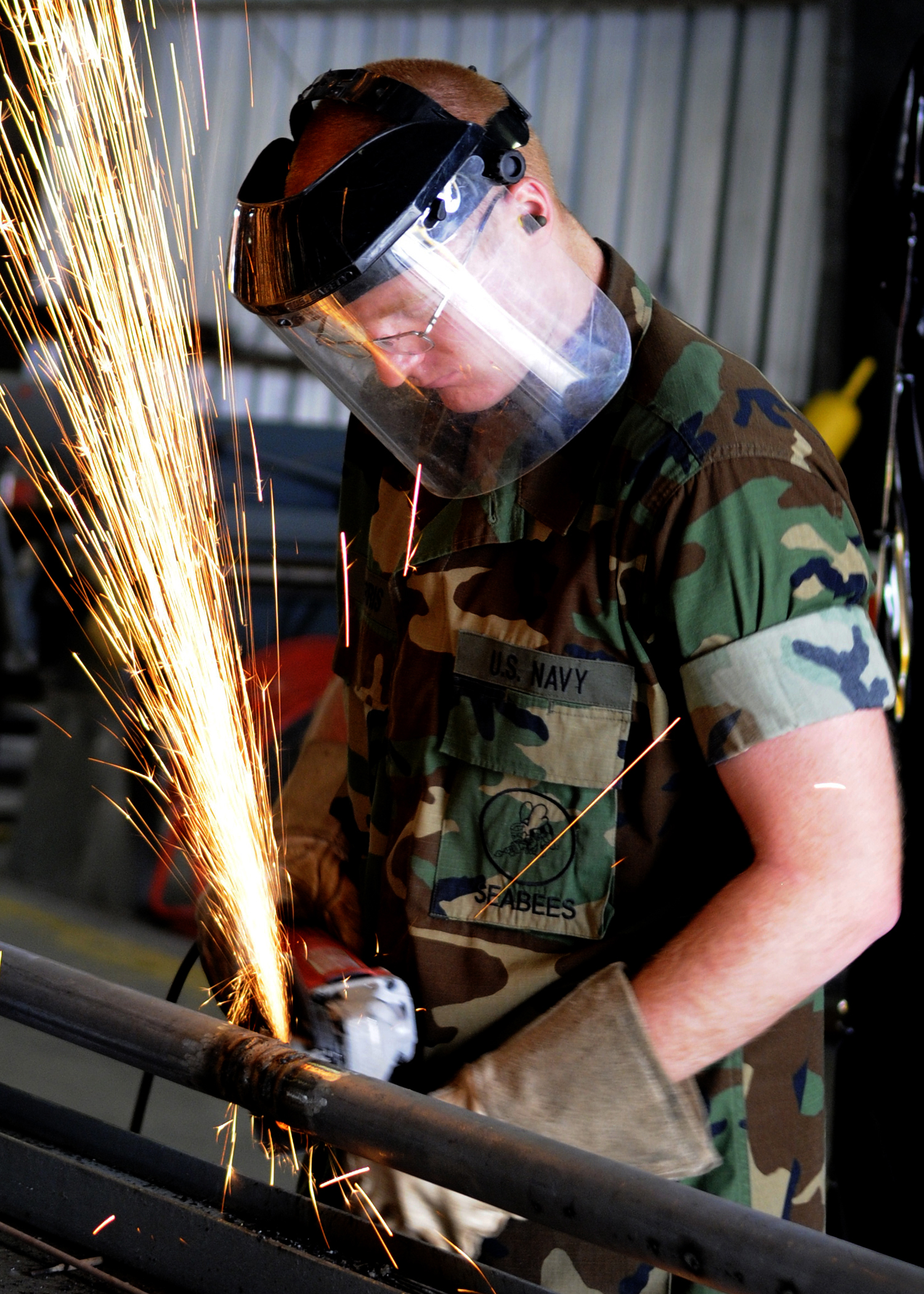 File:US Navy 100422-N-6357K-005 A Seabee grinds a pipe ...
