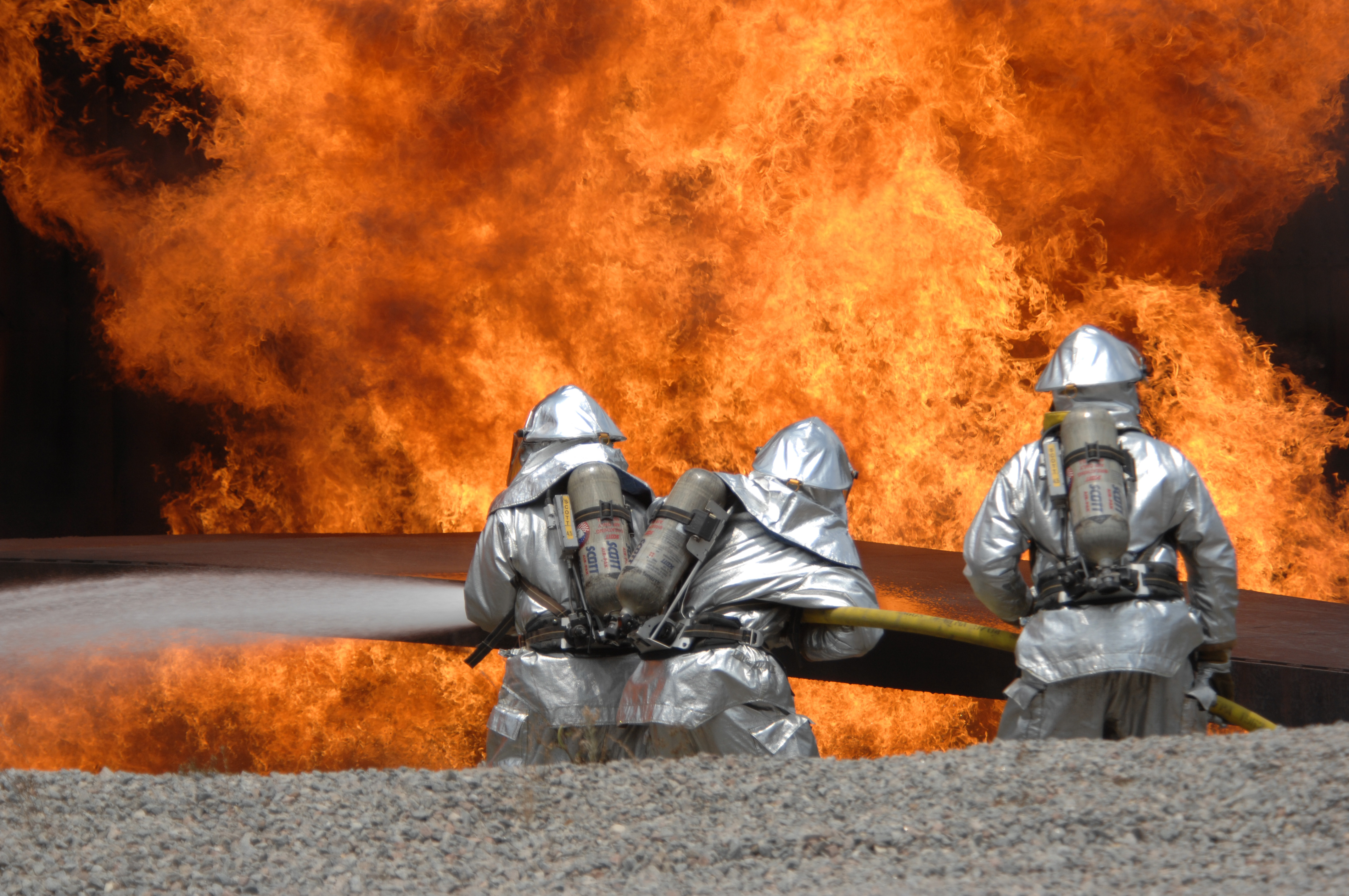 USAF airmen from the 20th Civil Engineer Squadron Fire Protection Flight neutralize a live fire during a field training exercise at Shaw Air Force Base.
