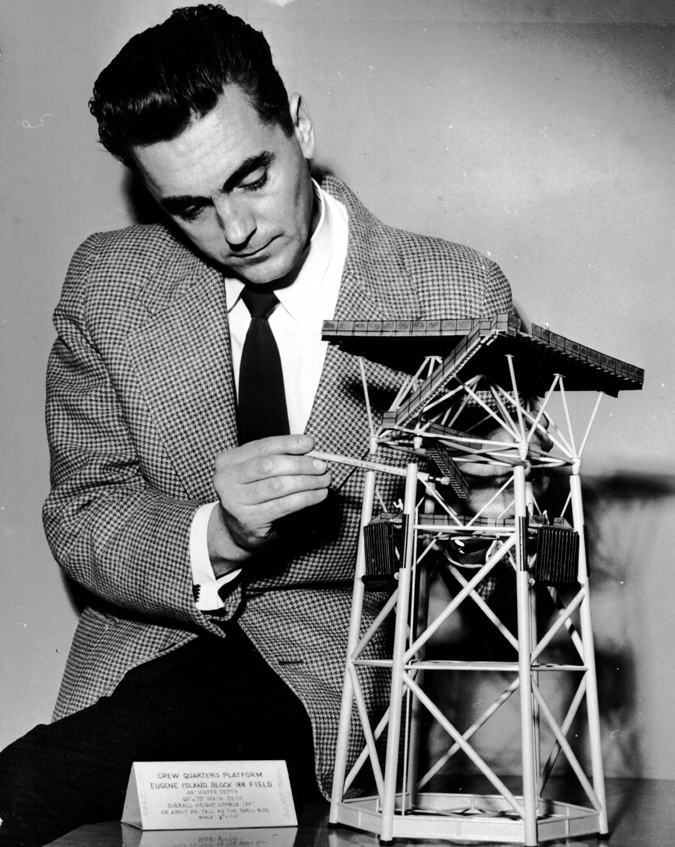 Iwo Pogonowski with model for his design of a hexagonal-base [[oil platform
