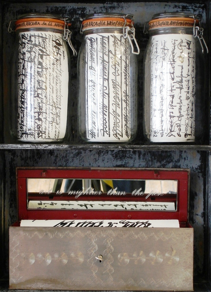Letter to Marcel Broodthaers, 2005. Wooden cabinet with canvas rolls in glass pots. Safe with canvas roll under mirror deck with text 'Art is Mightier than