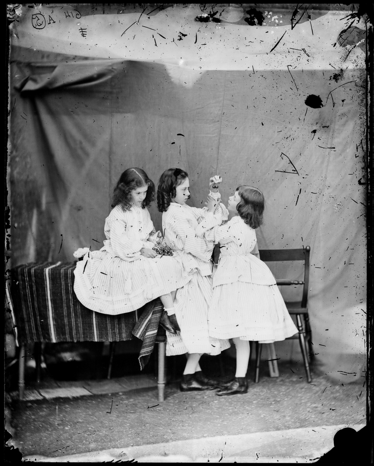 http://upload.wikimedia.org/wikipedia/commons/5/5b/Liddell,_Edith,_Lorina_%26_Alice,_%27Open_your_mouth...%27_(Lewis_Carroll,_07.1860).jpg
