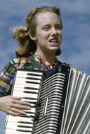 Lois Duncan Steinmetz playing the accordion aboard the shantyboat Lazy Bones (cropped).jpg