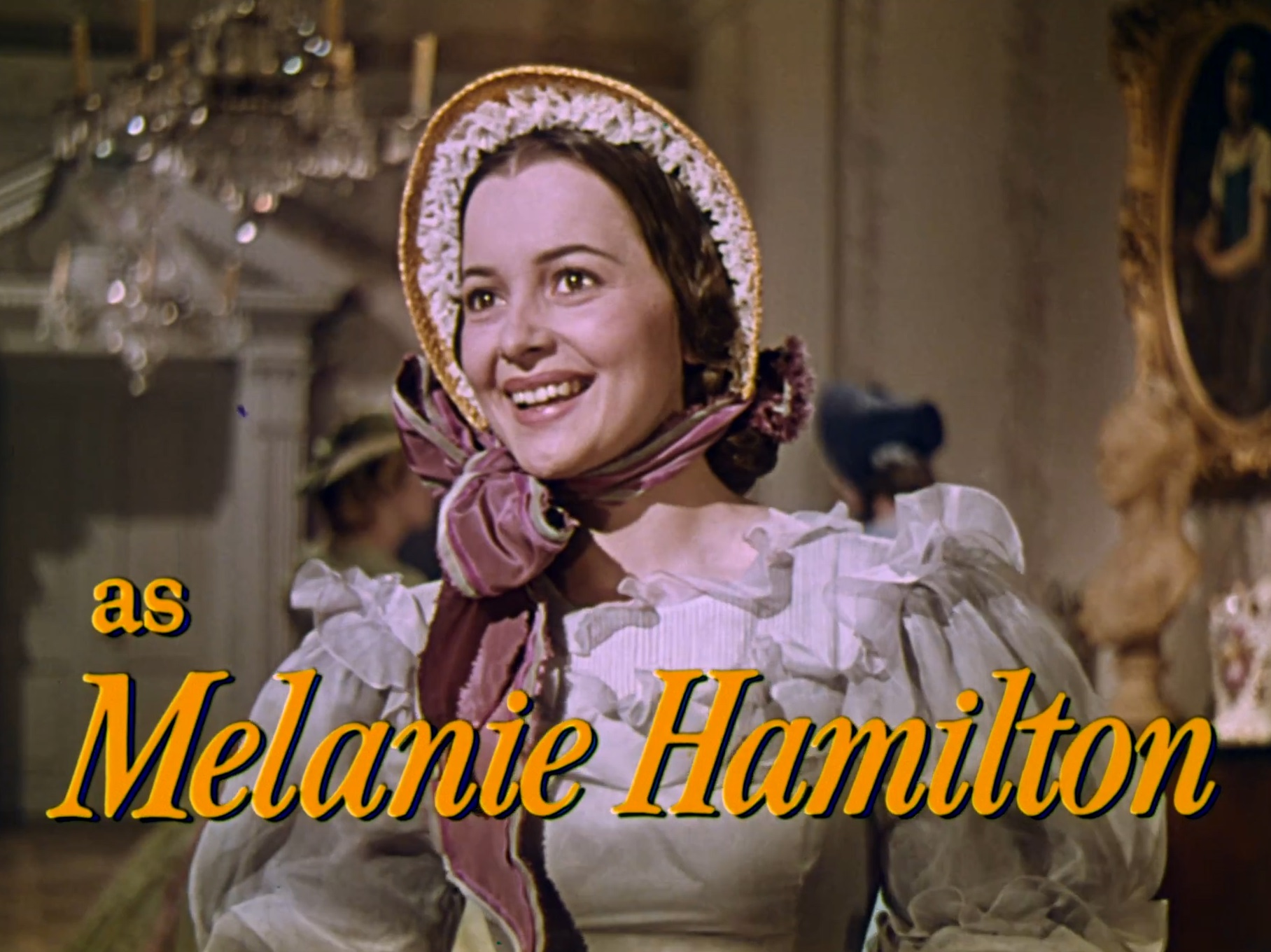 http://upload.wikimedia.org/wikipedia/commons/5/5b/Olivia_de_Havilland_as_Melanie_Hamilton_in_Gone_With_the_Wind_trailer.jpg