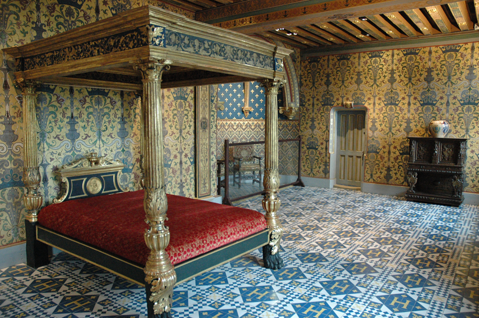 The Chambre du Roi with Henry IV's H in the floor tiles