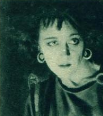 "Vera James, in the Universal film, ""The Attic of Felix Bavu"" (Mar 1923).png"
