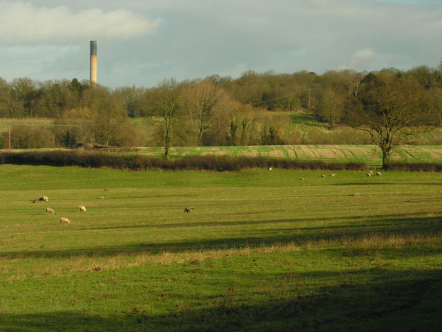 View across fields with unidentified chimney in distance - geograph.org.uk - 324202
