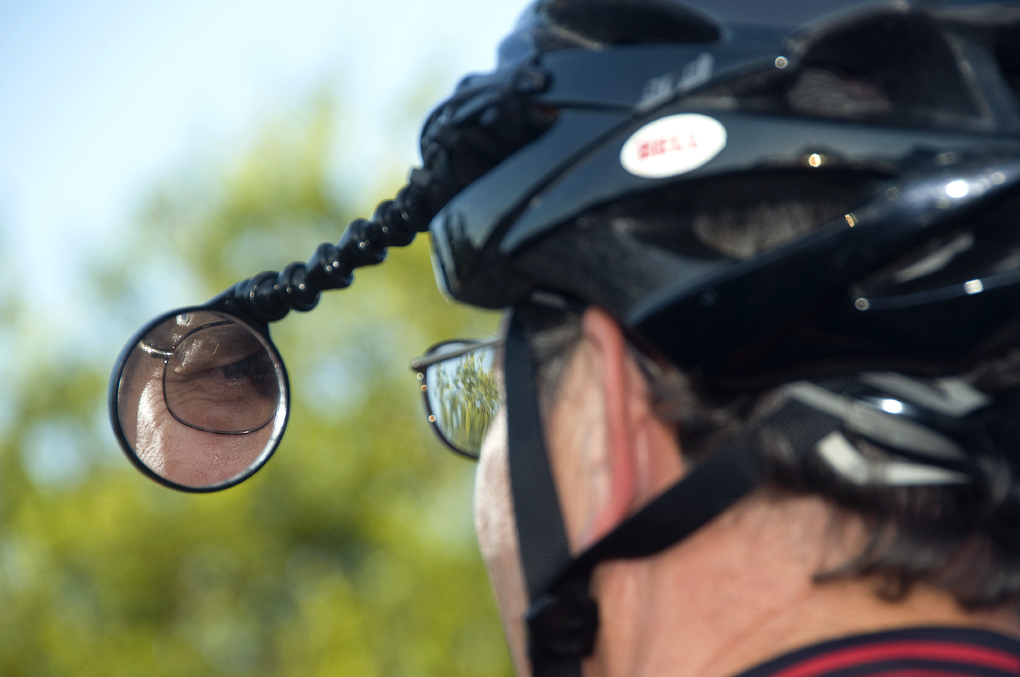 Bicyclist_with_a_rearview_mirror_attache