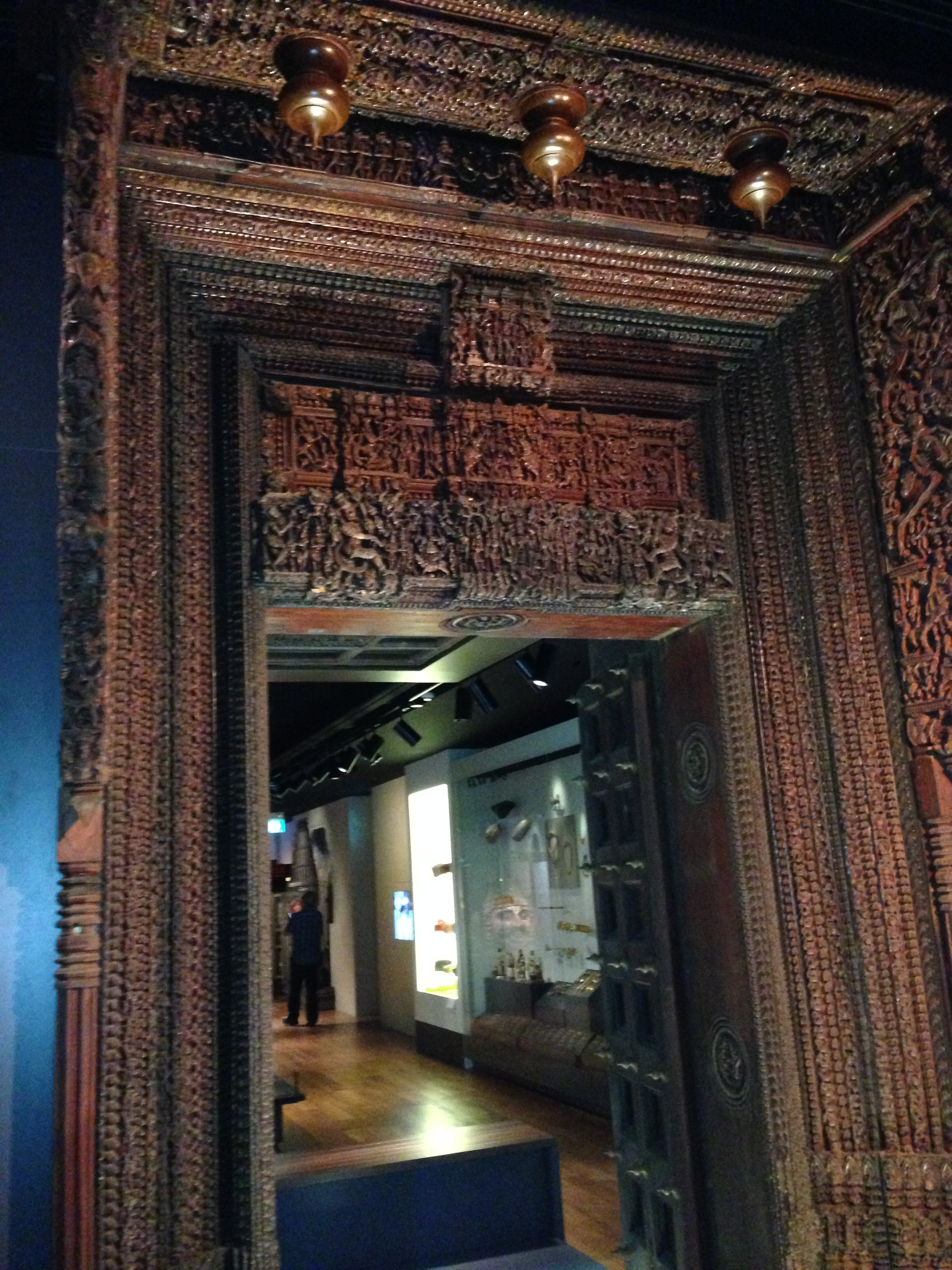 An intricately carved wooden Chettinad doorway (late 19th – early 20th century) in the Indian Heritage Centre, Singapore.