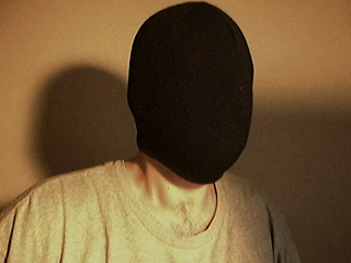 A person wearing a mask to avoid recognition