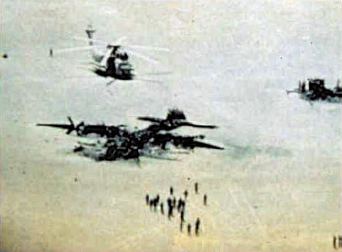 Overview of the wreckage at the Iranian Desert after the failed rescue operation by Delta Force, April 1980 Eagle Claw wrecks at Desert One April 1980.jpg
