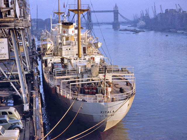 1962 Pool of London, Kodachrome slide. A vessel of the French line Chargeurs 'Kitala' awaits loading