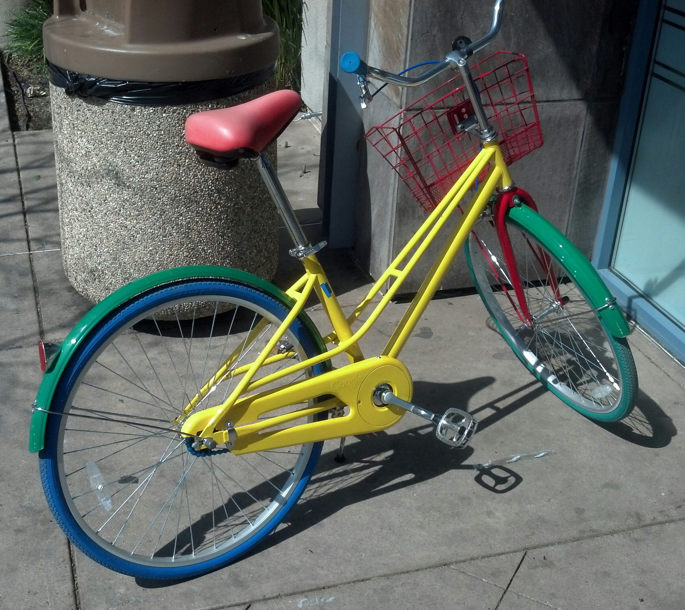Bicycles painted in the corporate color scheme are available for free use by any employee travelling around the Googleplex