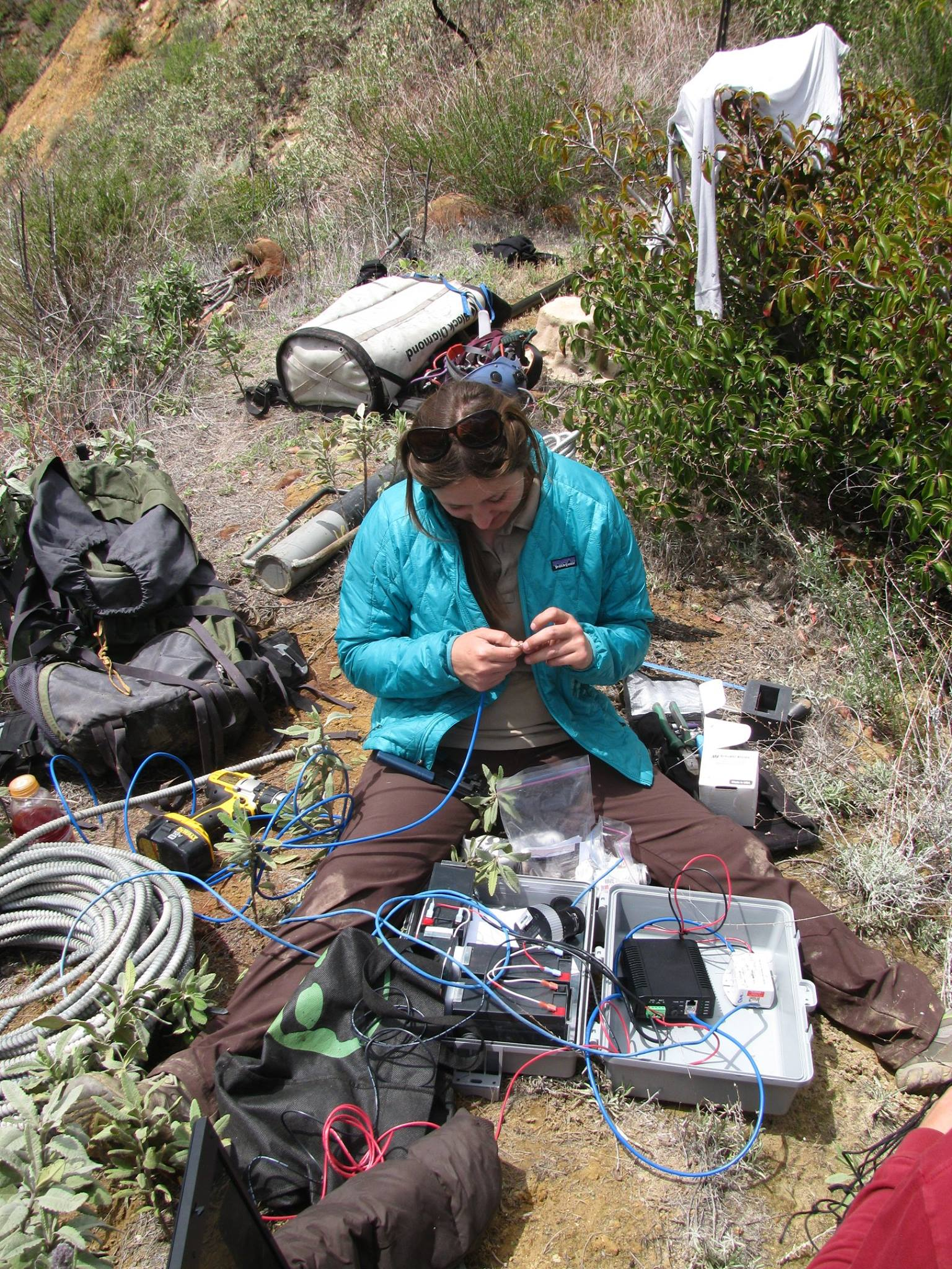 USFWS, works with ethernet cables and other equipment to get a nest camera online. Photo by USFWS. Date 29 July 2015, 18:01 Source Nest Camera Equipment Author