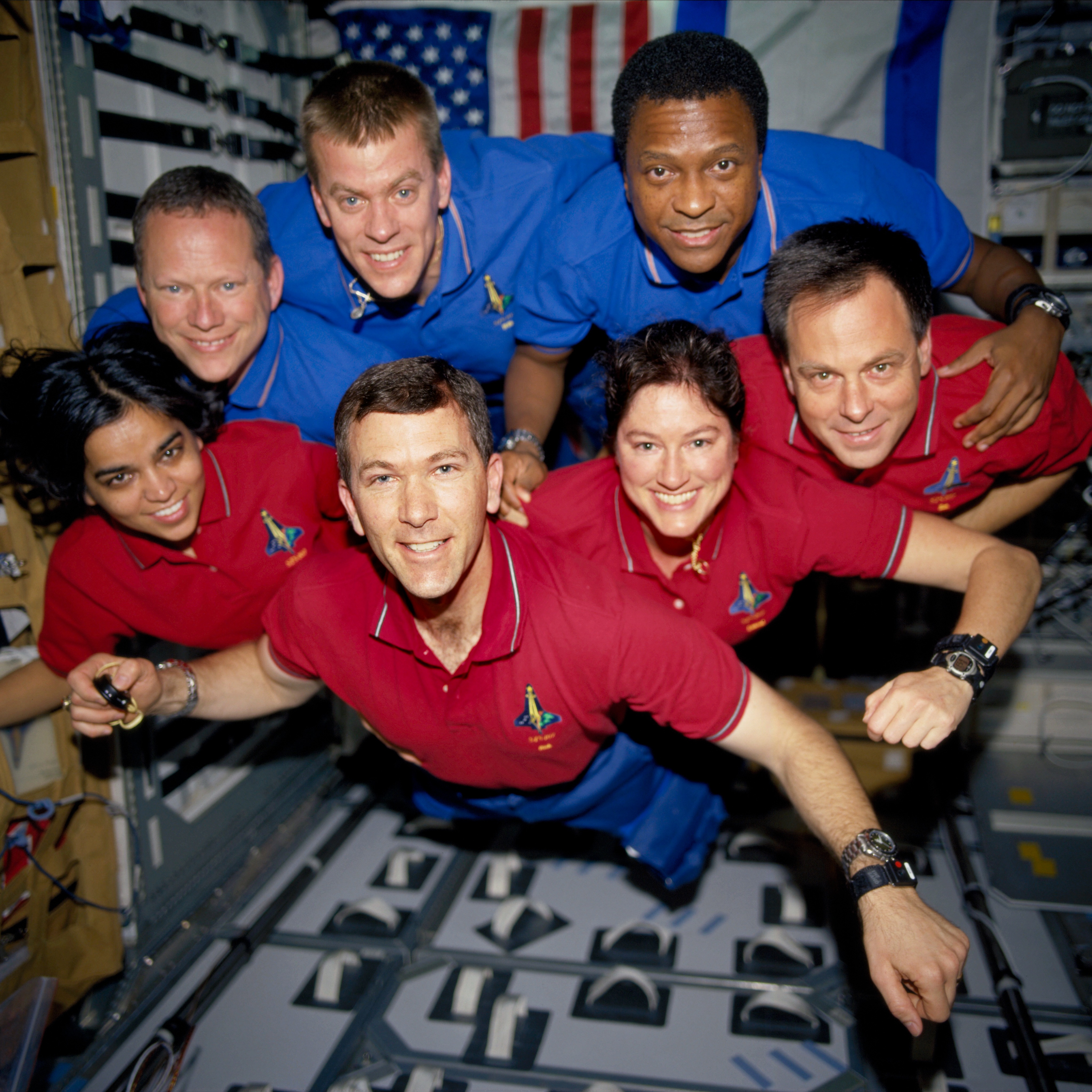Folded Corner: The STS-107 crewmembers strike a 'flying' pose. Picture was recovered from a roll of film found in the STS-107 crash debris.