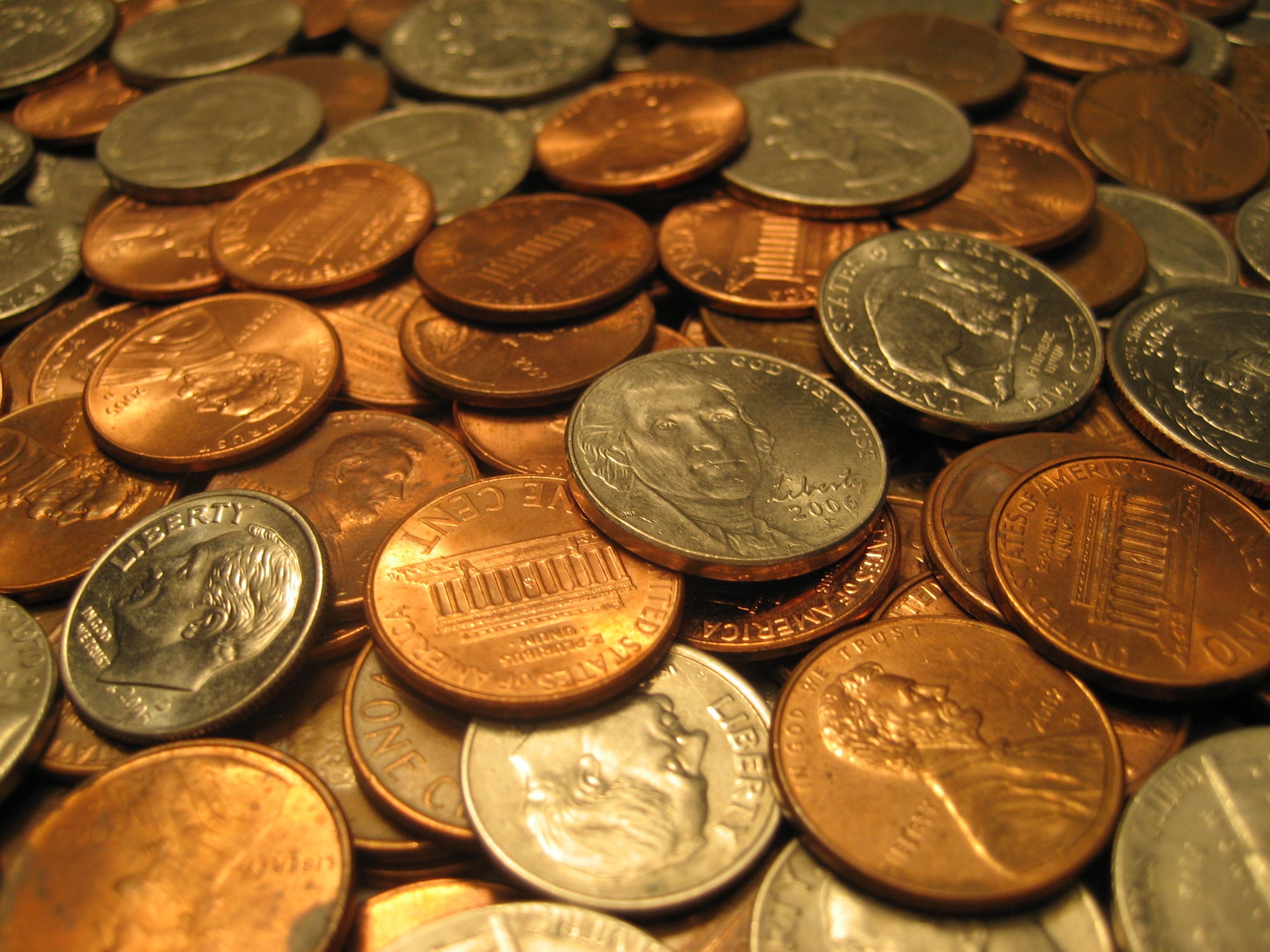 Pennies, nickles, dimes, quarters in pile