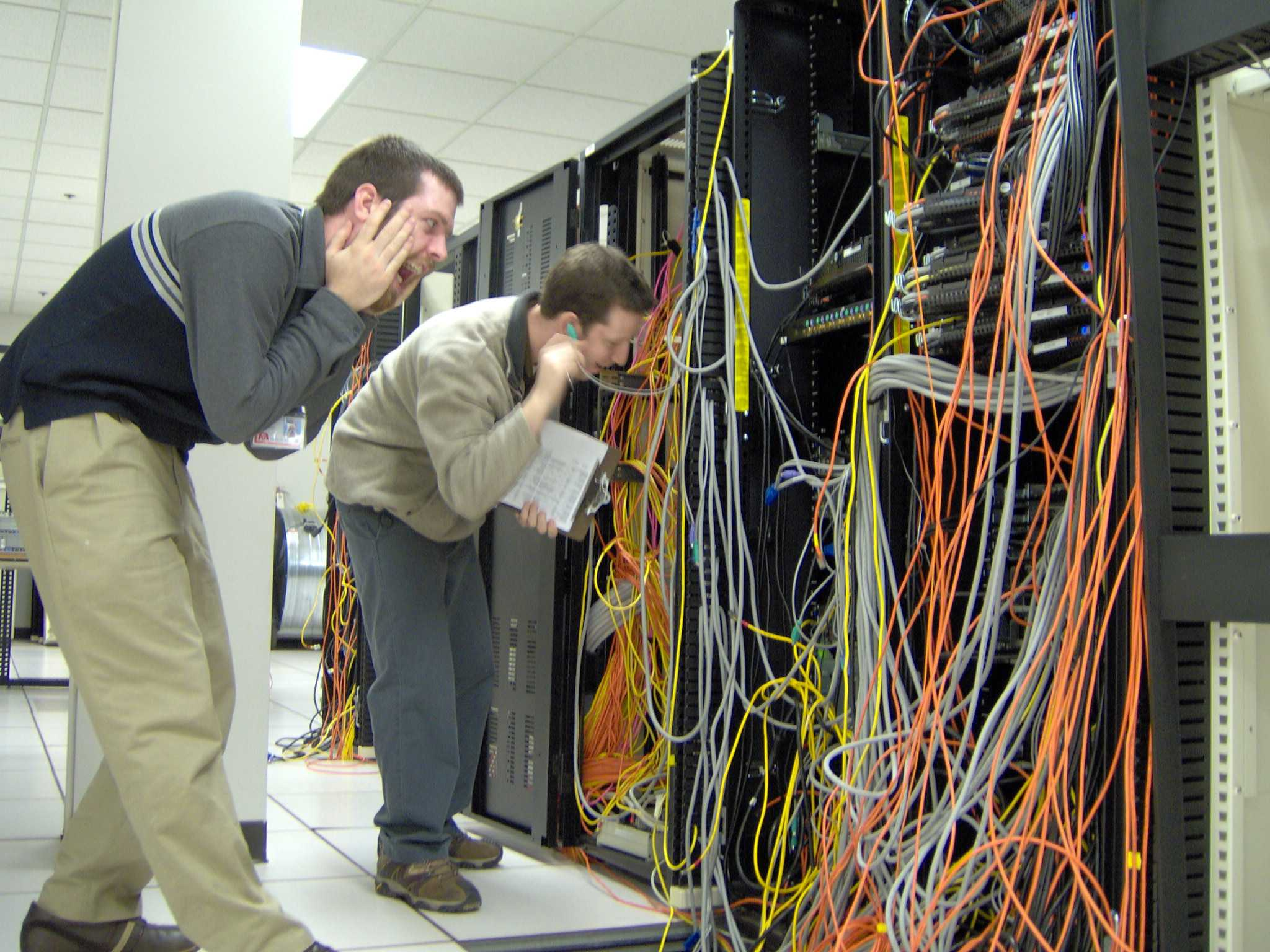People gawking at a cabling horror, which is just one of the stranger pictures I've stumbled across on Creative Commons