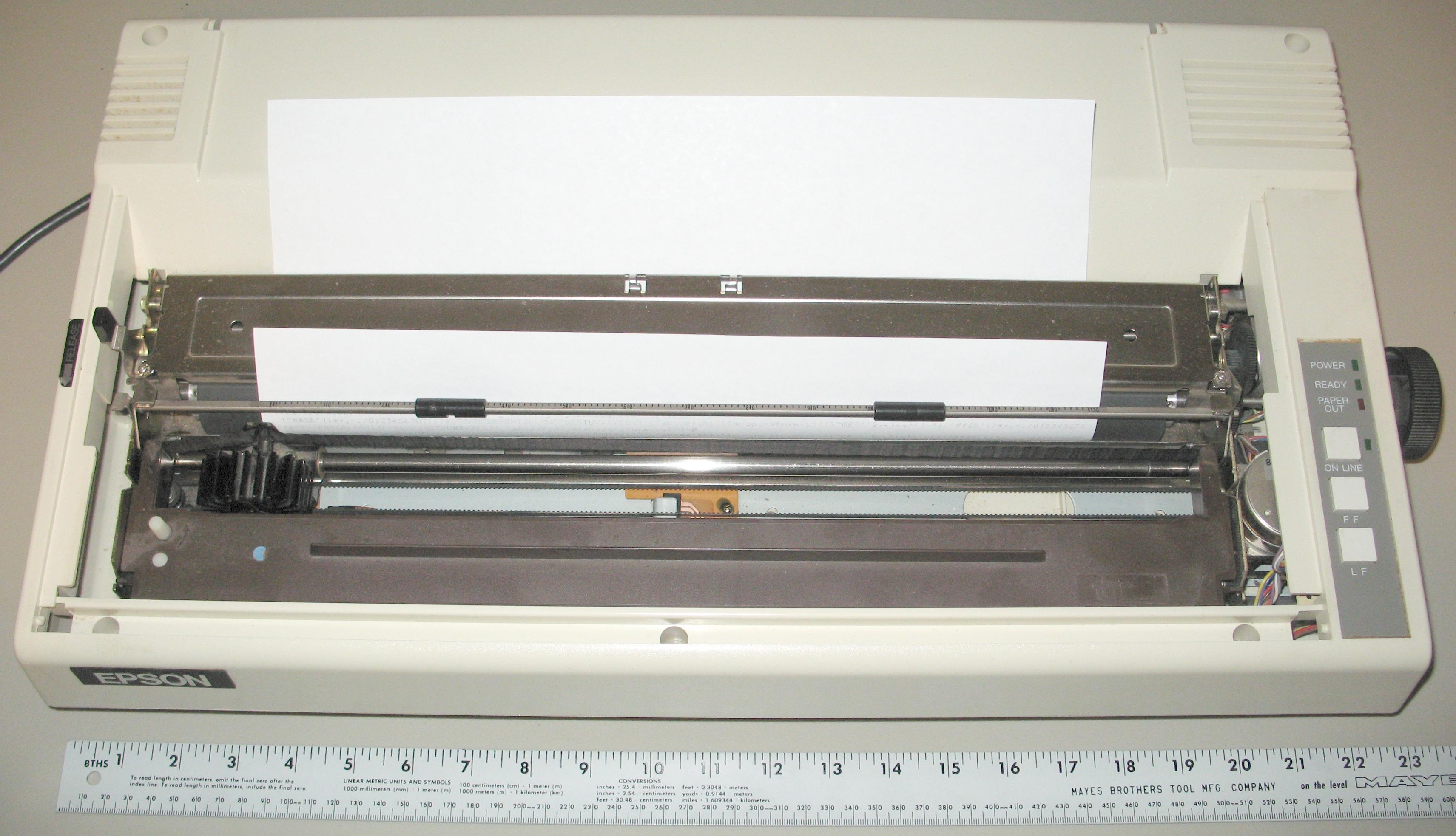 "hisisanexampleofawide-carriagedotmatrixprinter,designedforwidepaper,shownwithlegalpaper.idecarriageprinterswereoftenusedinthefieldofbusinesses,toprintaccountingrecordsontractor-feedpaper.heywerealsocalled""132-columnprinters""."