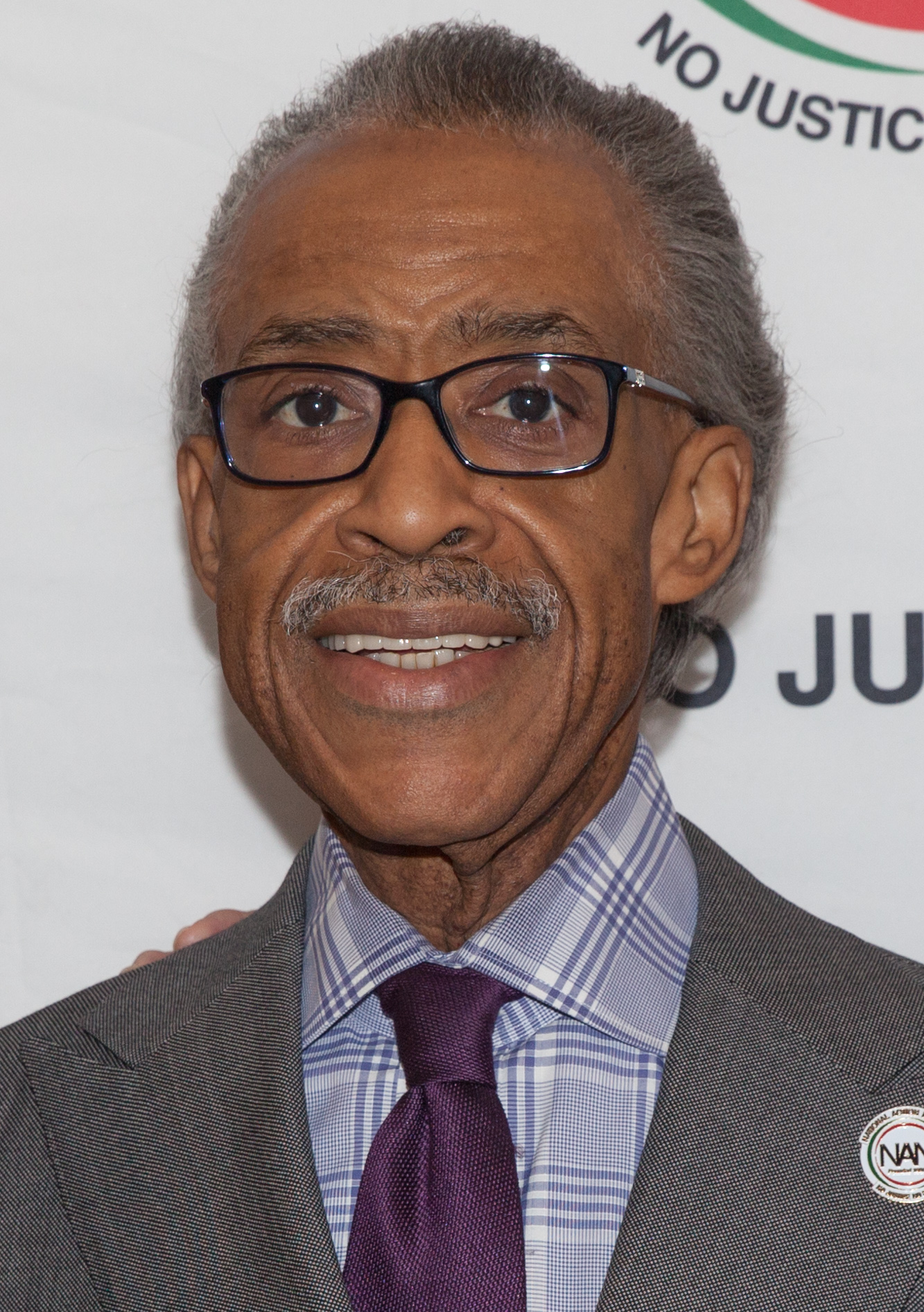 Link for the lazy.  https://upload.wikimedia.org/wikipedia/commons/5/5f/Al_Sharpton_January_2015.jpg  https://en.m.wikipedia.org/wiki/Al_Sharpton