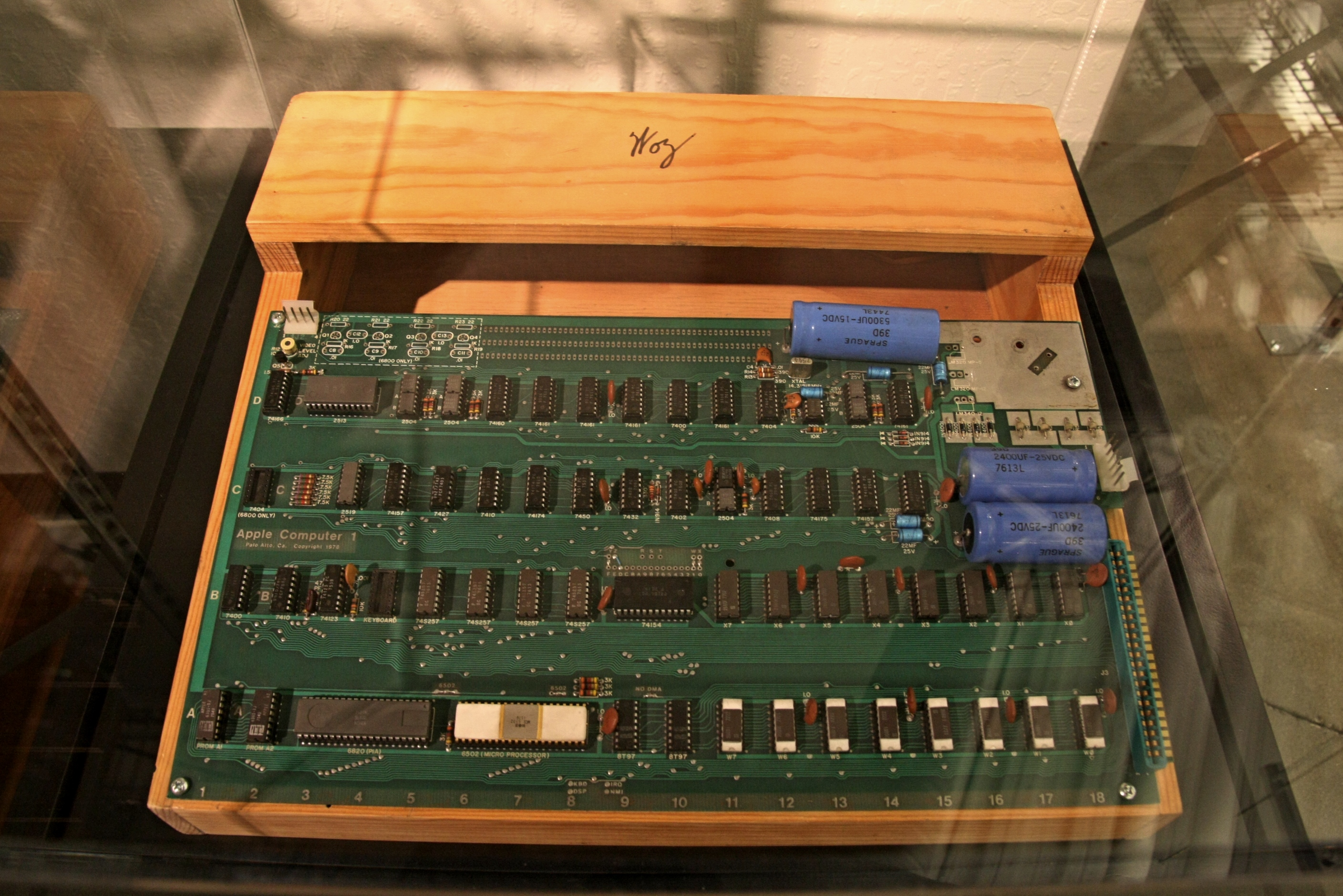 File:Apple I circuit board and wooden case with Woz sign, Computer ...
