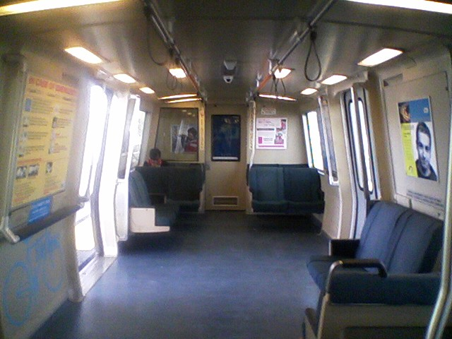 A Demonstration Car (modified C2 car) with a designated bike space in the area normally reserved for passengers in wheelchairs; the front-facing seat on the left-hand side of the car has been removed to accommodate bicycles, in turn, the aisle-facing seat on the right-hand side near the operator's cab has been removed to accommodate wheelchairs. This car also has hand straps.