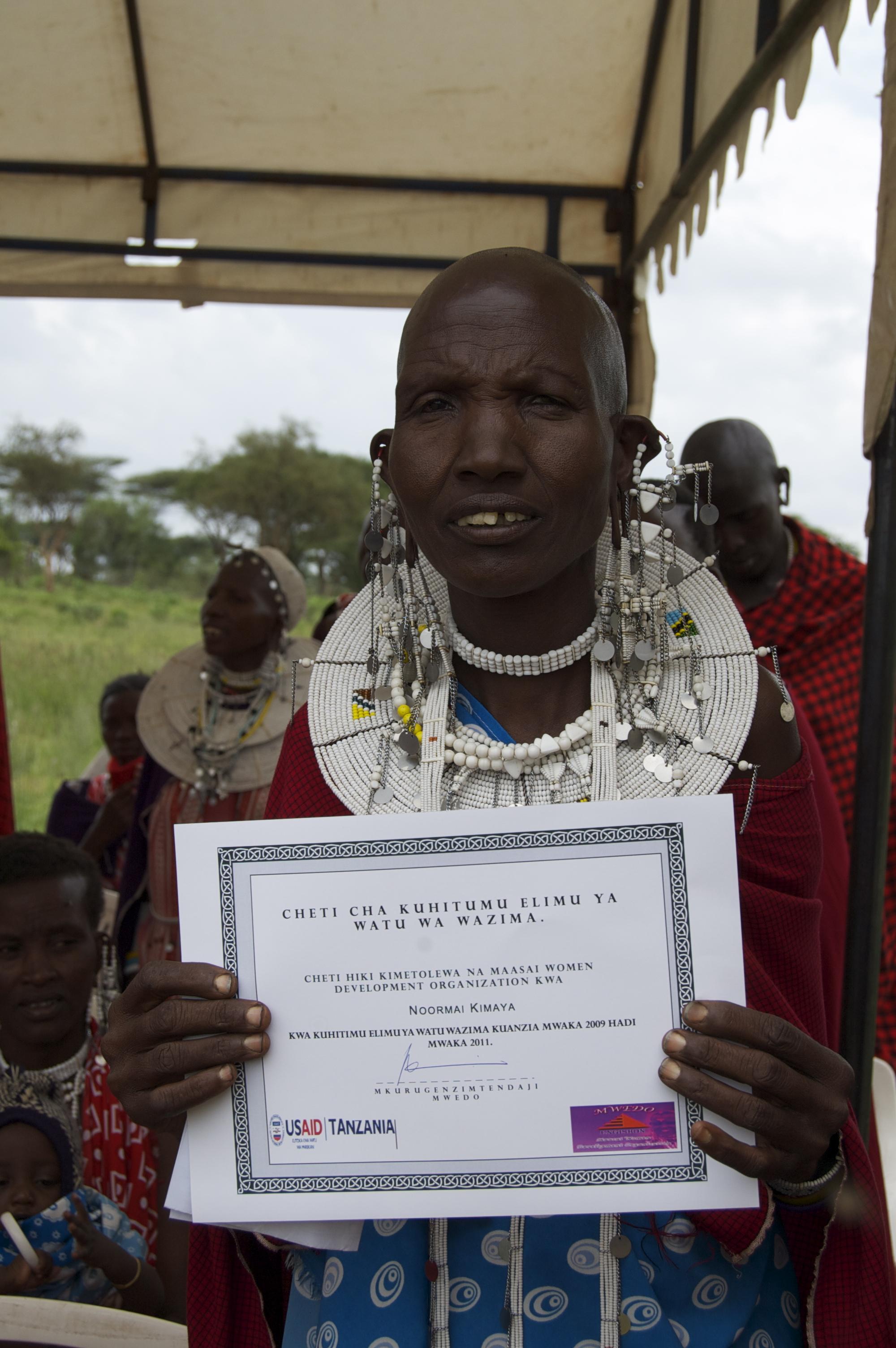 Filemaasai Women Shows Certificate Of Accomplishment 6595764029