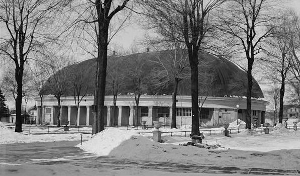 a black and white photo of a snowy, domed Mormon tabernacle in SLC, Utah