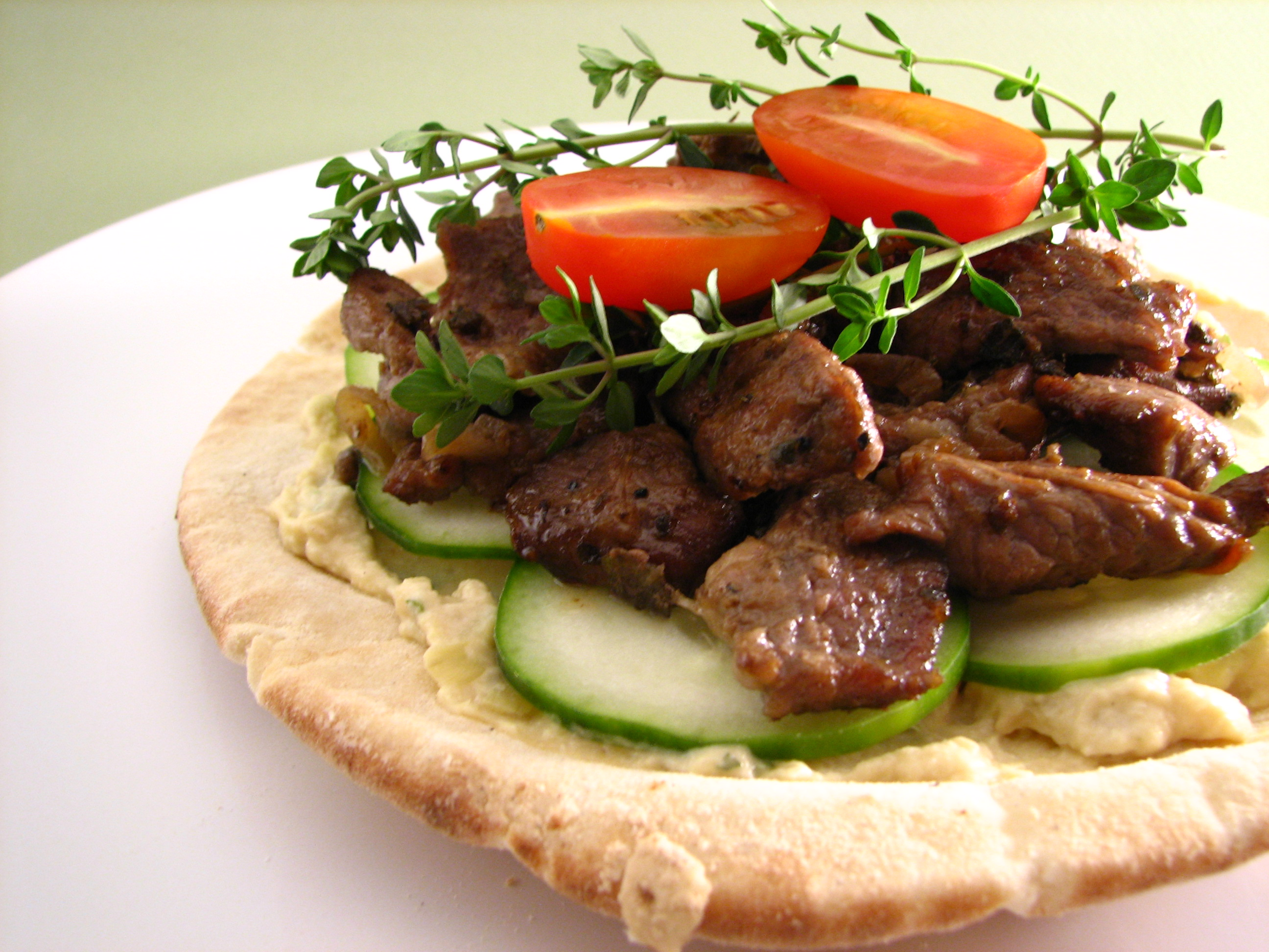 File pita topped with artichoke hummus and for Arabic cuisine food