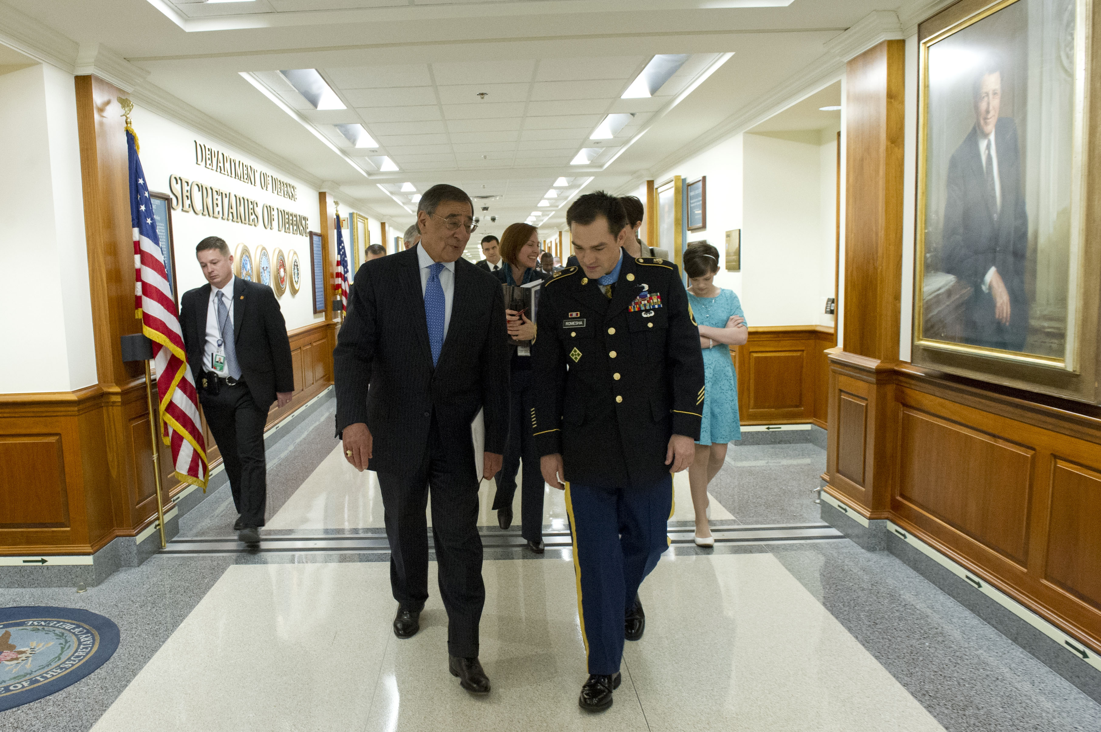 File:Secretary of Defense Leon E. Panetta walks through the hallways of the Pentagon with Army ...