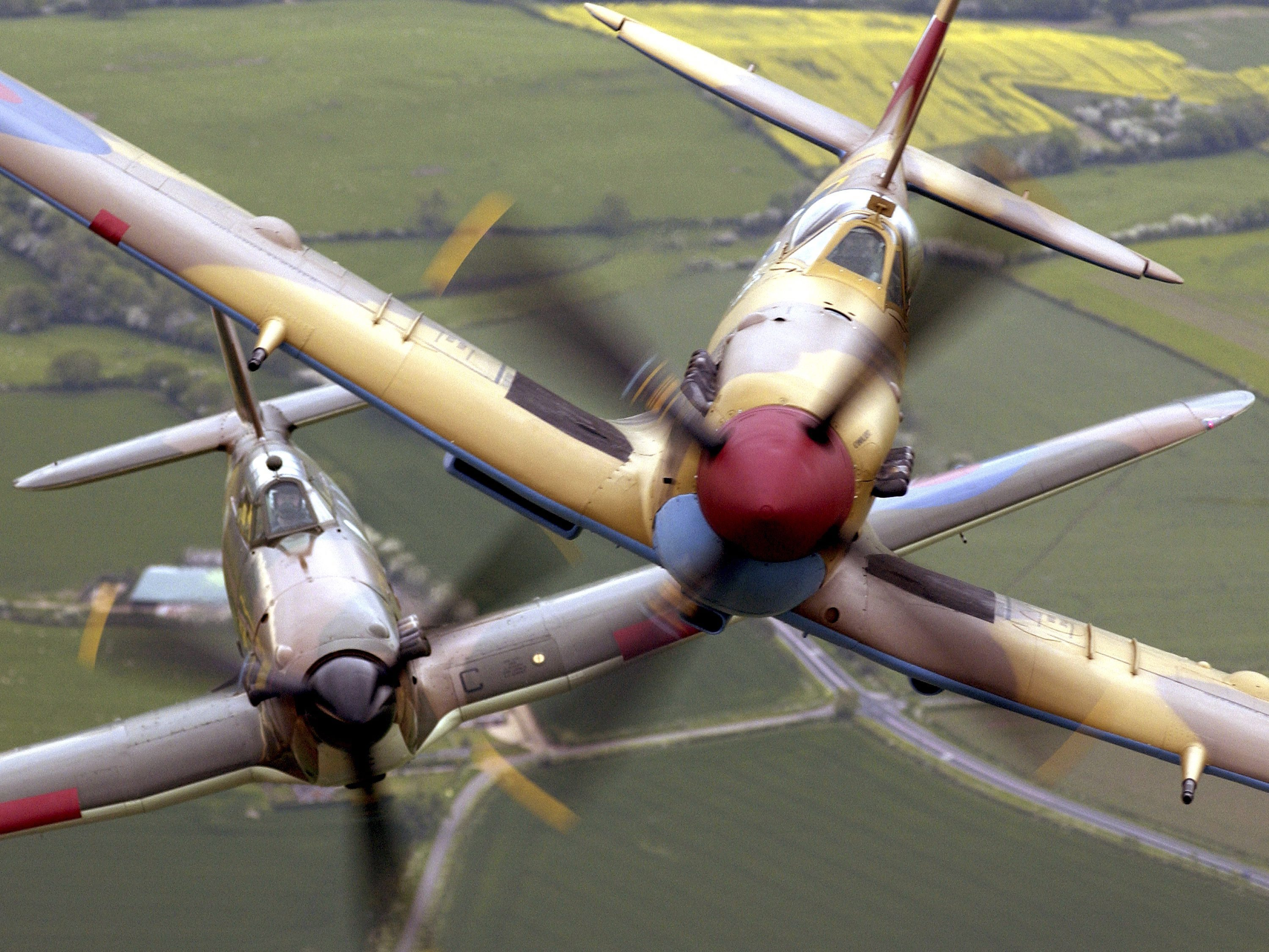 Spitfire_and_Hurricane_in_flight_MOD_451