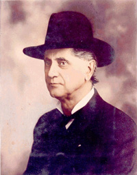 A faded photograph of William G. Steel, founder of The Mazamas climbing club named after the volcano, who is seated and wearing a hat