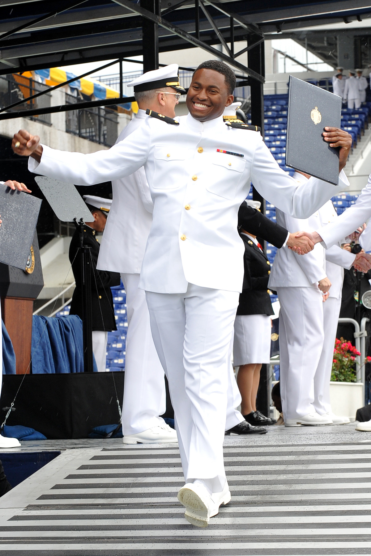 file a u s naval academy graduate receives his diploma during the