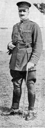 a full length view of a man in uniform with a cane