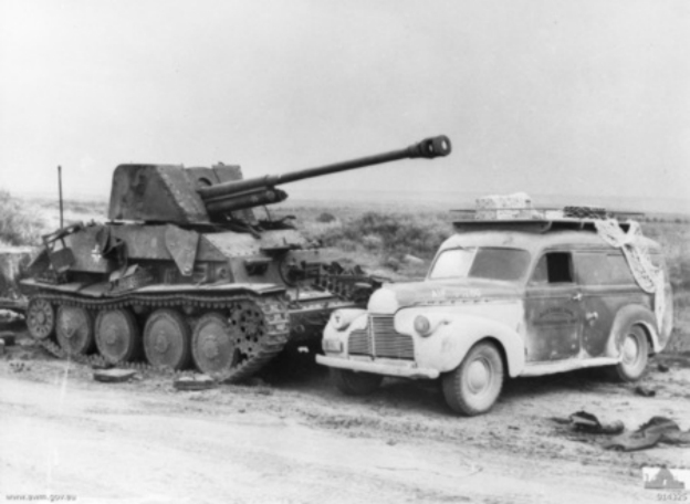 A Chevrolet Panel van next  to an abandoned Marder III in North Africa