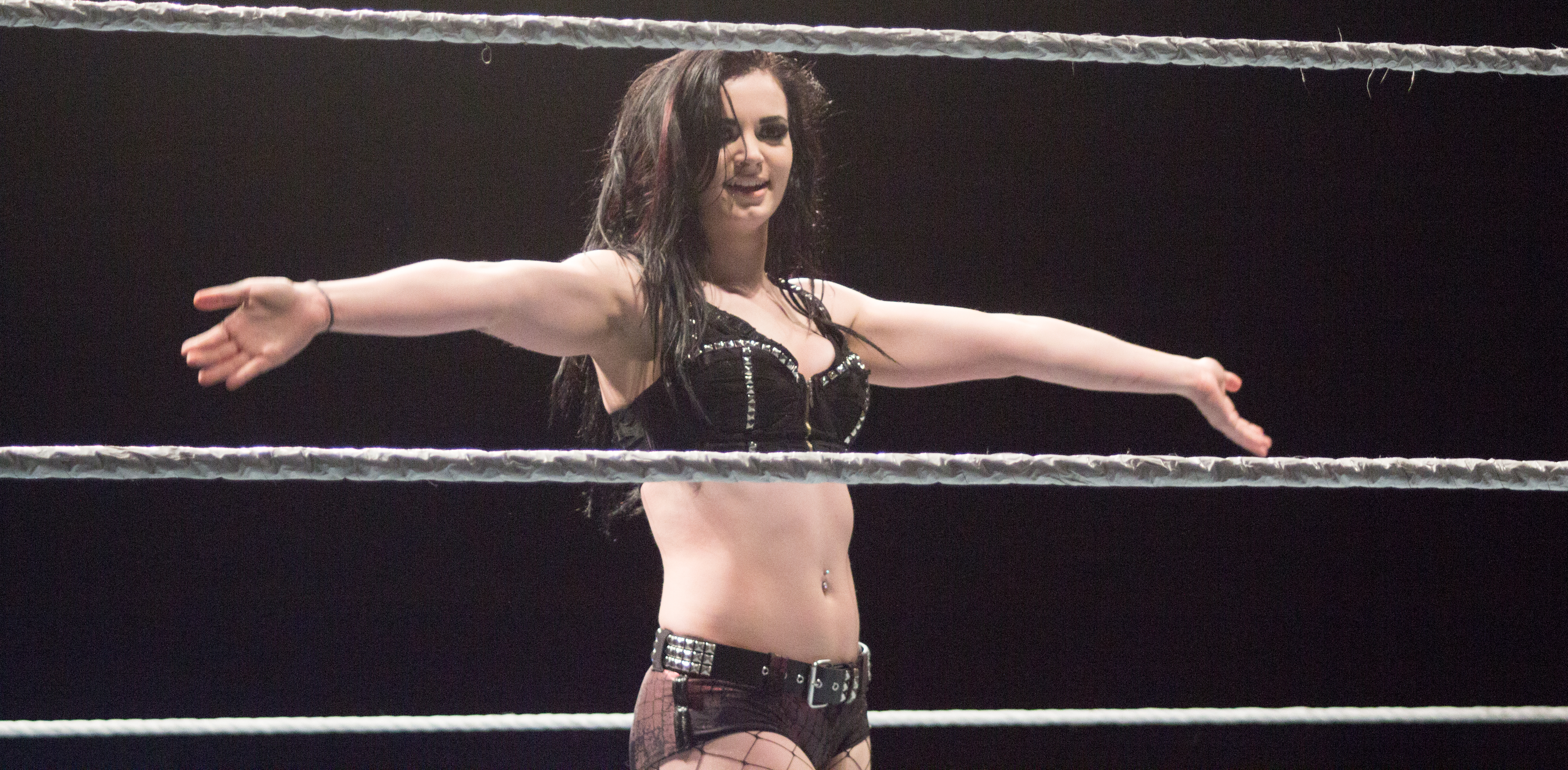 Paige celebrates in the ring.