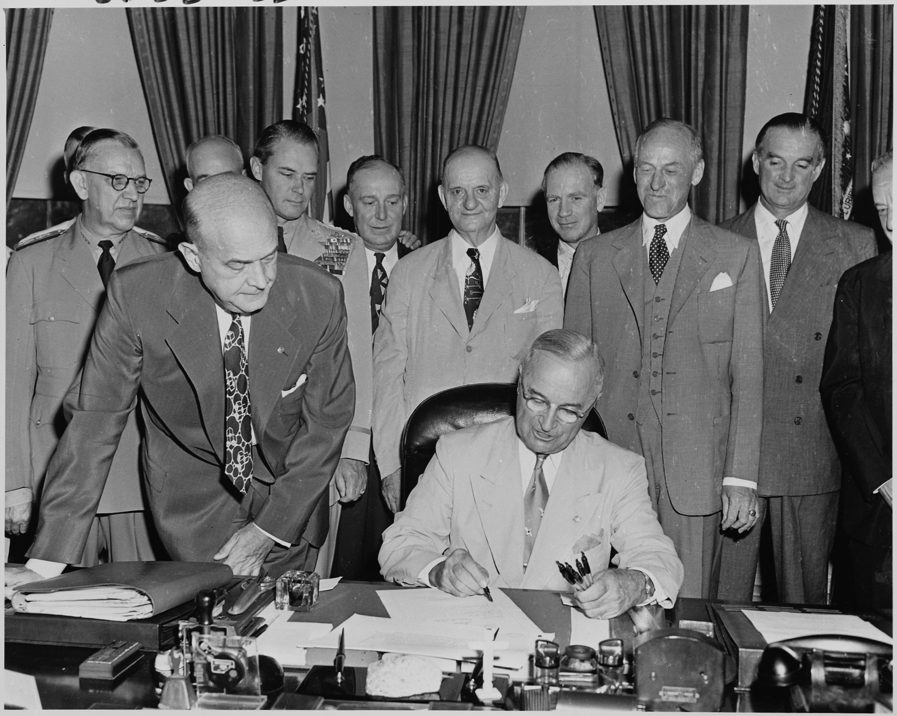 President Truman signs the National Security Act Amendment of 1949
