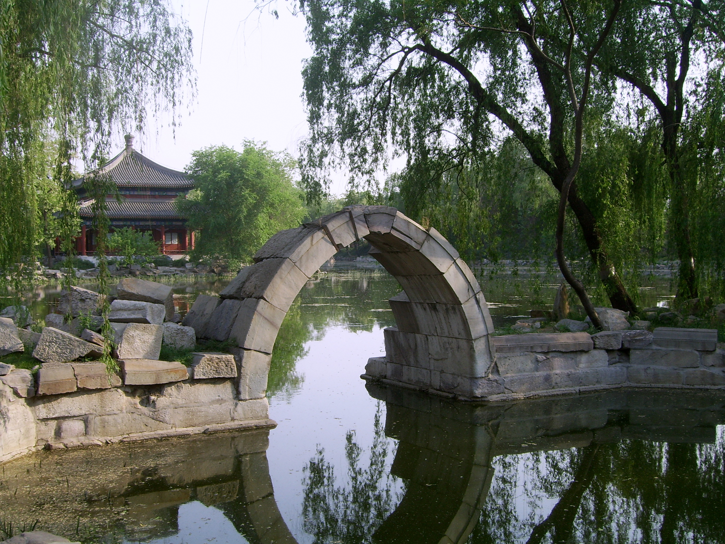 The pavilion and the stone arch are among the few remaining buildings in the Old Summer Palace