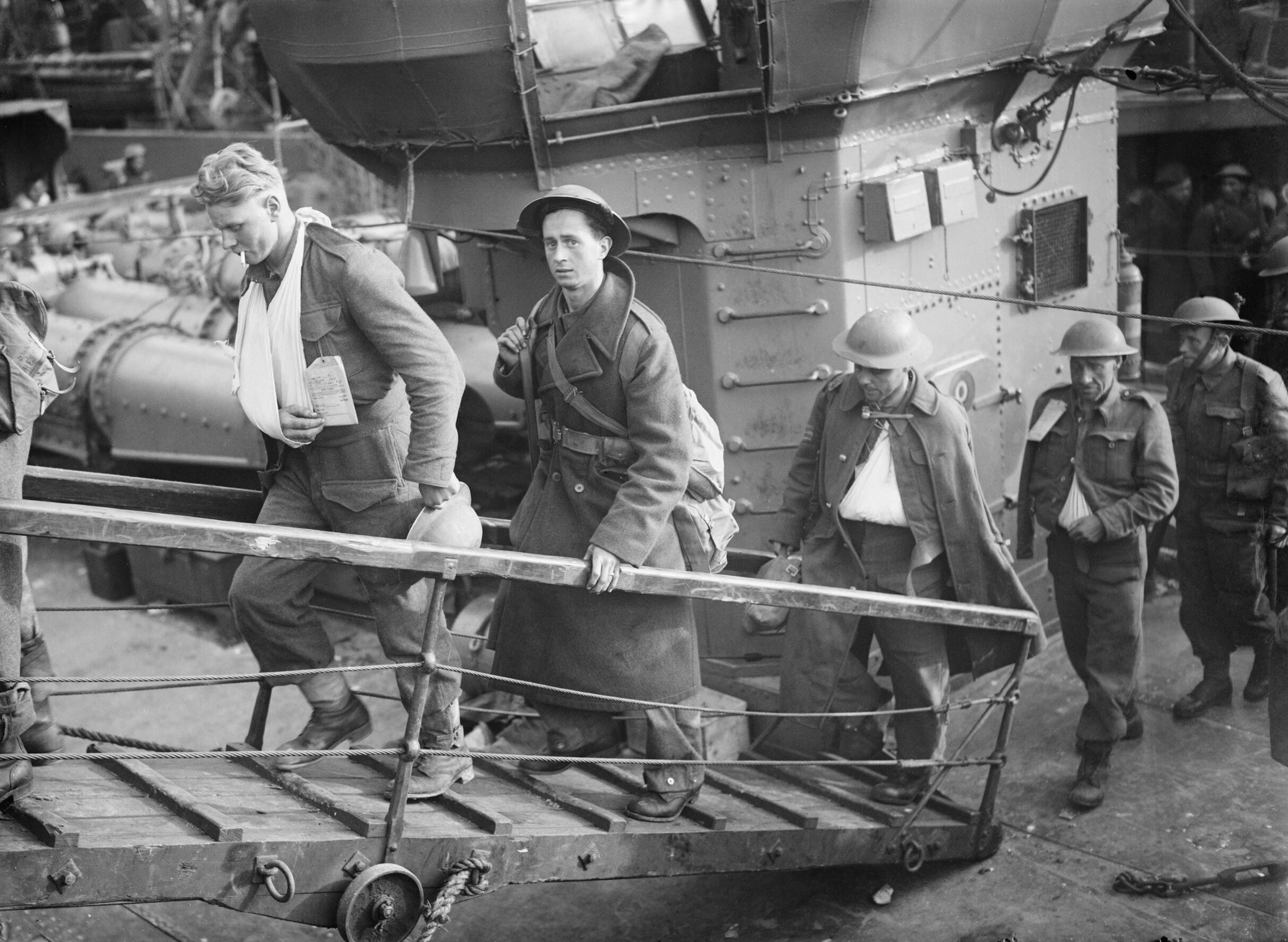 Wounded British soldiers evacuated from Dunkirk make their way up the gangplank from a destroyer at Dover, 31 May 1940. H1623.jpg