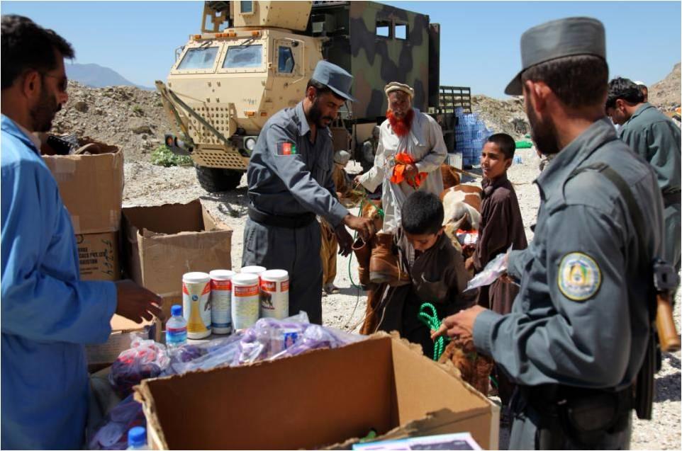 File:Afghan National Police officers, hand out medicine ...