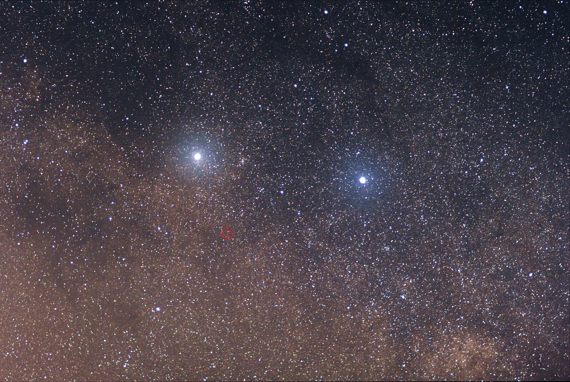The two bright stars are (left) Alpha Centauri and (right) Beta Centauri. The faint red star in the... [+] center of the red circle is Proxima Centauri. Image credit: Wikimedia user Skatebiker, CC A-SA 3.0